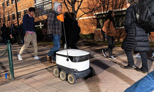 A cooler-sized robot on the street